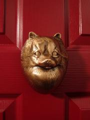 Pomeranian Dog Knocker shown on Door