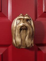 Maltese Bronze Dog Knocker shown on Door